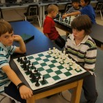 The boys trying hard to stifle their enthusiasm for chess!