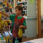 Eric at the Craft Shop, YMCA Camp, Estes Park - making a tie-dye shirt