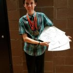 Alex cleans up in academic awards night
