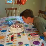 Eric's 14th birthday attempting to blow out candles that re-light!