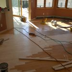 The hardwood floors being extended into new dining room and other places it wasn't before