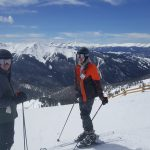 The boys at the top of A-basin with Keystone to the right beyond and Breckenridge on each side of Eric's helmet.