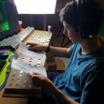 Alex sorting through 1000's of coins to fuel his love of coin collecting