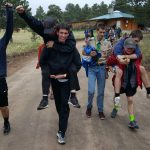 Scout summer camp. The troop celebrates winning the big relay race!