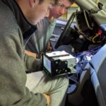 Brothers trying to figure out wiring on new 'radio'