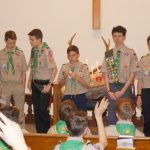 March -Receiving merit badges at Court of Honor