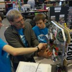 Alex working on the team robot during competition