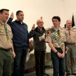 Alex surrounded by other Eagle scouts of all ages