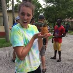 Janaye on a mission trip to Jamaica with her church - admiring a pygmy pineapple