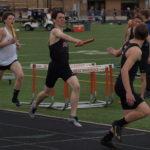 Alex handing off in the 4x800 meter relay