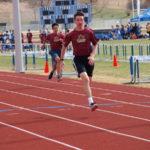Eric winning his 100 meter heat