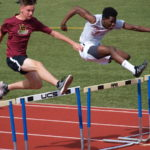 Eric battling it out in hurdles